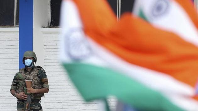 An Indian security officer stands guard during a graduation parade at the Air Force Academy in Dundigal, on the outskirts of Hyderabad, India.(AP)