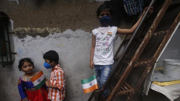 Children hold Indian flags as they celebrate Independence Day in Dharavi, one of Asia's biggest slums, in Mumbai.(AP)