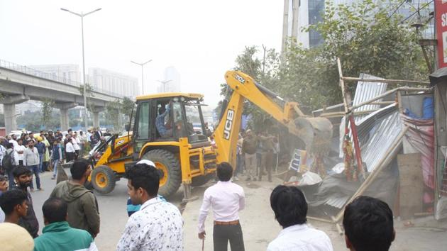 Officials said that the incident took place when a team of DTCP officials started a demolition drive in an unauthorised colony in Sector 72A. The area has been designated by the department as an open space zone by the DTCP.(Yogendra Kumar/HT PHOTO)