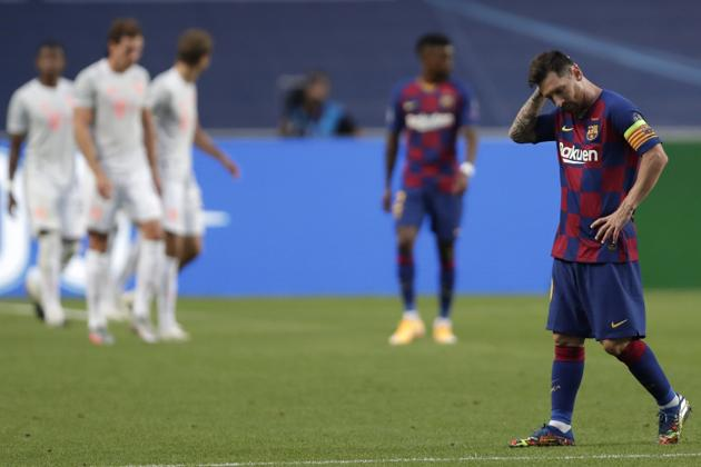 "Barcelona's Lionel Messi holds his head during the Champions League quarterfinal match between FC Barcelona and Bayern Munich at the Luz stadium in Lisbon, Portugal, Friday, Aug. 14, 2020. Gerard Piqué says Barcelona ""hit rock bottom"" in an 8-2 humiliation from Bayern Munich in the Champions League quarterfinals. It's 74 years since Barcelona conceded eight goals in a game. (AP Photo/Manu Fernandez/Pool)(AP)"