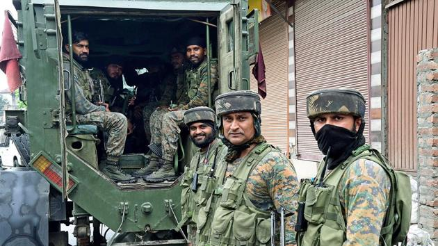 Security personnel during a patrol around the Natipora area in Srinagar on Wednesday.(ANI PHOTO.)