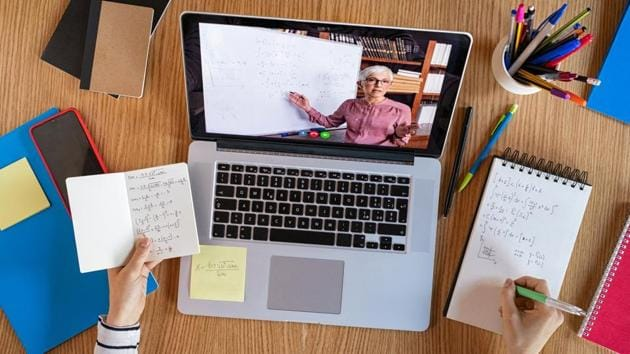 High angle view of video conference with teacher on laptop at home.(Getty Images/iStockphoto)
