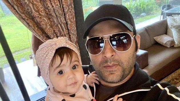 Kapil poses with daughter Anayra.