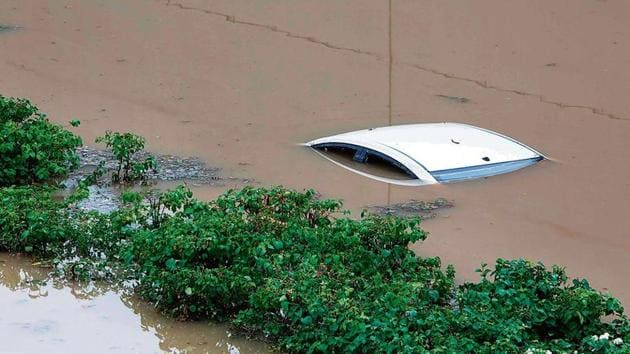 A submerged car is seen in a flooded underpass at Gurugram's Golf Course Road after heavy monsoon rain in NCR on Wednesday.(AFP Photo)