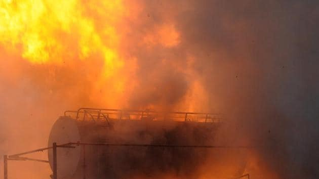 A view of the transformer up in flames inside the power substation after it caught fire, at Safipur village, in Sector 148, Noida