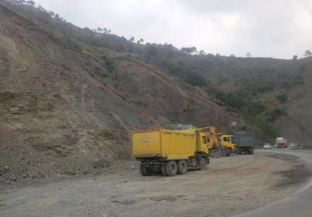 Work in progress on the Parwanoo-Solan highway widening project on Friday. The National Highway Authority of India plans to complete work on it by December this year.(HT Photo)