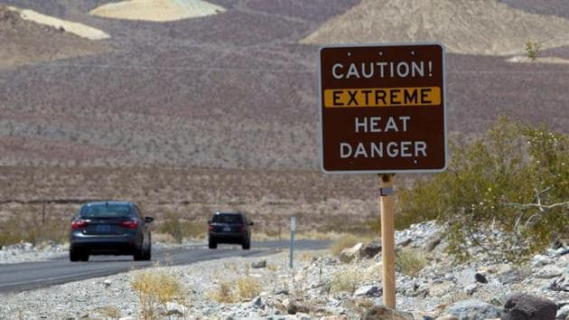A sign warns of extreme heat as tourists enter Death Valley National Park in California.(Reuters File Photo)