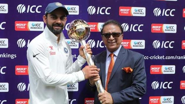 Sunil Gavaskar presents Virat Kohli Captain of India with the ICC Test Mace during day four of the fourth test match between India and Australia held at the Himachal Pradesh Cricket Association Stadium on the 28th March 2017. Photo by: Ron Gaunt / BCCI/ SPORTZPICS