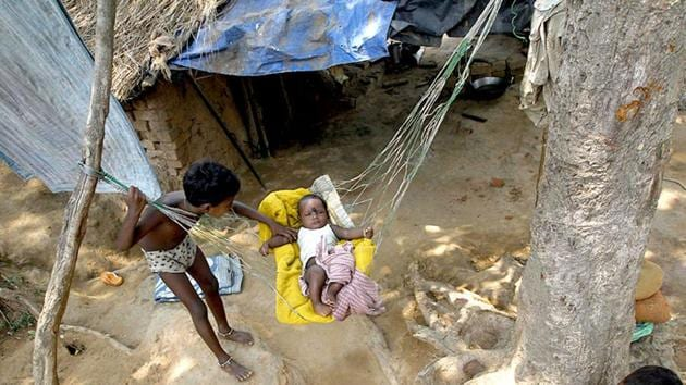 The Pradhan Mantri Awas Yojana (PMAY), which is an upgraded version of the United Progressive Alliance (UPA)-era Indira Awas Yojna, is aimed at uplifting the rural poor.(AP Photo)