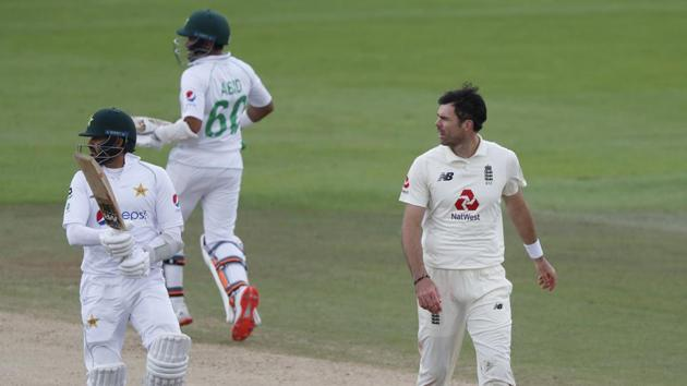 England's James Anderson, right, watches as Pakistan's captain Azhar Ali, left, and Abid Ali run between the wickets to score during the fourth day of the third cricket Test match between England and Pakistan, at the Ageas Bowl in Southampton, England, Monday, Aug. 24, 2020.(AP)