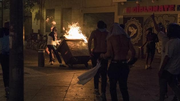 Fans hurl a burning container at riot police during violent celebrations of Bayern Munich's victory, Sunday Aug. 23, 2020 in Marseille, southern France, after the Champions League final soccer match between Paris Saint-Germain and Bayern Munich being played at the Luz stadium in Lisbon, Portugal. (AP Photo/Daniel Cole)(AP)