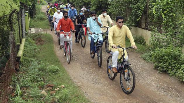 Superintendent of Police Shyam Singh along with other police official ride on bicycles inspecting the Visva-Bharati University area, in Bengal's Birbhum on Sunday.(PTI)