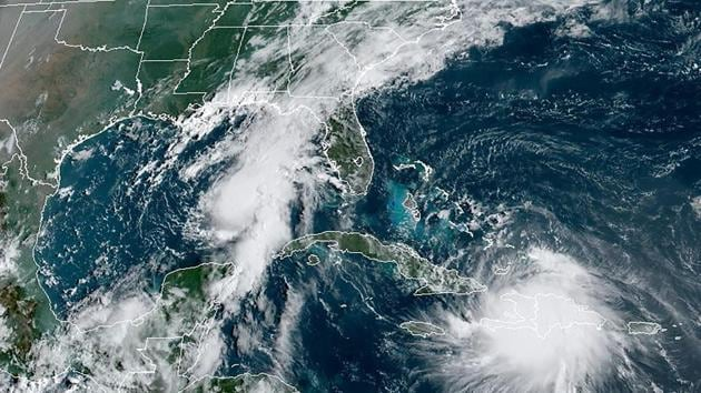 The Gulf Coast braced for a history-making onslaught from tropical storms Marco and Laura, with many evacuees recalling the damage caused by Hurricane Katrina in 2005.(AFP/ RAMMB/NOAA)