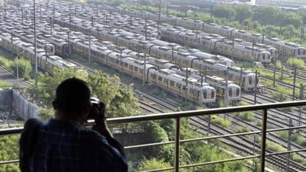 A man photographs Delhi Metro trains parked at Khyber Pass Metro Depot in New Delhi in this file photo. Metro services along with bars are likely to be allowed to resume from September 1.(Ajay Aggarwal /HT Photo)