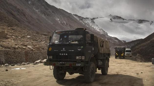 Indian Army vehicles drive on a road in Ladakh region near the border with China(AP)