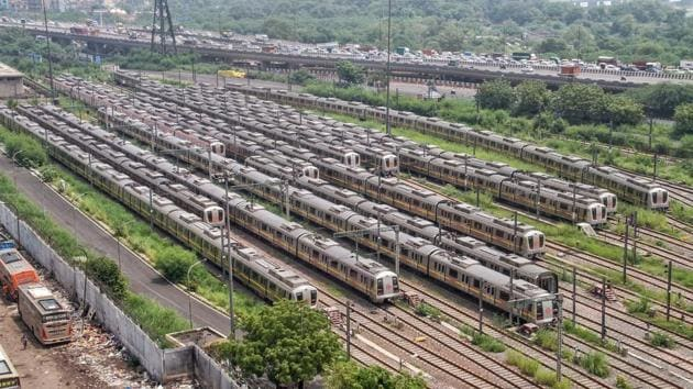 Metro trains are parked at DMRC depot in Delhi. Inspections conducted by forest department officials between February 25 and July 28 showed that six fully grown trees on the stretch were illegally uprooted or over-pruned during construction.(PTI/ Representative image)