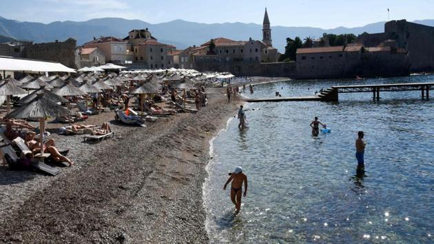 Tourists enjoy the beach in the coastal town of Budva, one of the major tourist spots at Montenegro's Adriatic coast, on August 17, 2020.(SAVO PRELEVIC / AFP)