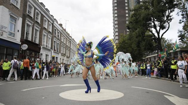 London's Notting Hill Carnival traces its roots to the emancipation of Black slaves and race riots in the city during the late 1950s.(AP Photo/Tim Ireland, File)