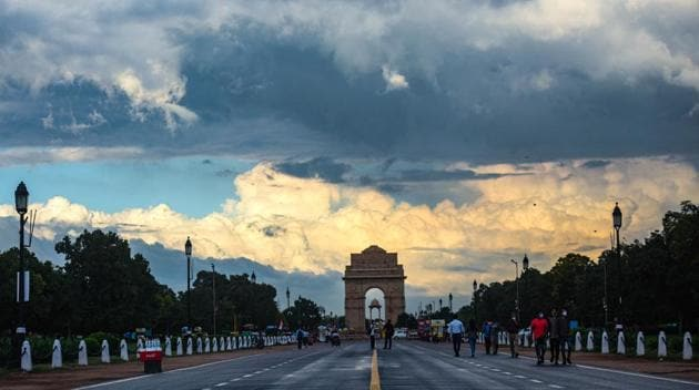 Clouds hover over India Gate in New Delhi. Data accessed by HT shows that nearly 175,000 people have been fined by Delhi Police for not wearing masks till August 23.(Amal KS/HT PHOTO)