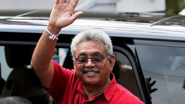 Sri Lanka's President Gotabaya Rajapaksa waves at his supporters as he leaves a polling station after casting his vote during the country's parliamentary election in Colombo, Sri Lanka.(REUTERS)