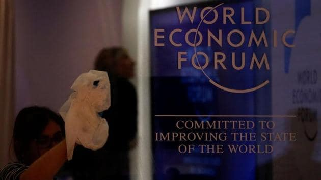 A worker cleans a window with a logo of the World Economic Forum (WEF) at the congress center, the venue of the annual meeting of the organization, in Davos, Switzerland January 19, 2020.(REUTERS/Denis Balibouse/Files)