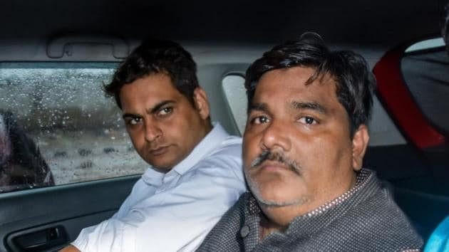 Suspended AAP councillor Tahir Hussain (right) is accused of being involved in the Delhi riots that took place in February.(PTI)
