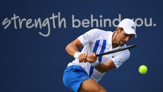Aug 26, 2020; Flushing Meadows, New York, USA; Novak Djokovic (SRB) hits the ball against Jan-Lennard Struff (GER) during the Western & Southern Open at the USTA Billie Jean King National Tennis Center. Mandatory Credit: Robert Deutsch-USA TODAY Sports(USA TODAY Sports)