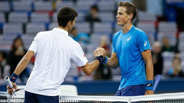 Novak Djokovic of Serbia shakes hands with Vasek Pospisil of Canada during a Shanghai Rolex Masters match.(Getty Images)