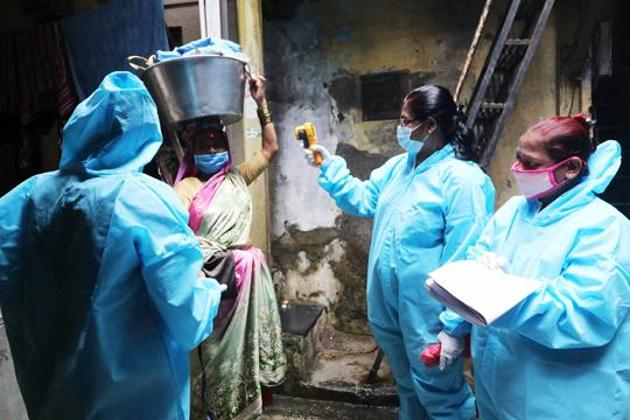 Healthcare workers wearing personal protective equipment (PPE) conduct door to door thermal screening of residents during a campaign to detect the coronavirus disease (Covid-19) in Mumbai's Dharavi. There were 76,472 new infections in the last 24 hours, according to the health ministry's dashboard.(ANI Photo)