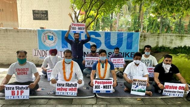 National Chairman of NSUI Social Media, Manoj Lubana and Vice-president of PUCSC 2019-2020, Rahul Kumar sit on hunger strike during a protest to postpone JEE-NEET exam, in front of the Congress Bhawan in Chandigarh on Saturday.(ANI)