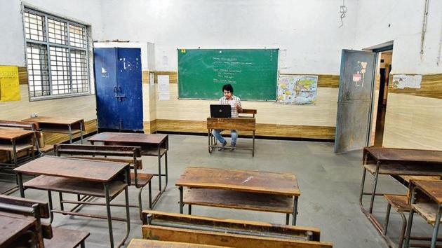 A teacher takes an online class from a government school in New Delhi.(PTI Photo)