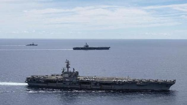 USS Ronald Reagan (CVN 76, front) and USS Nimitz (CVN 68, rear) Carrier Strike Groups sail together in formation, in the South China Sea.(AP)