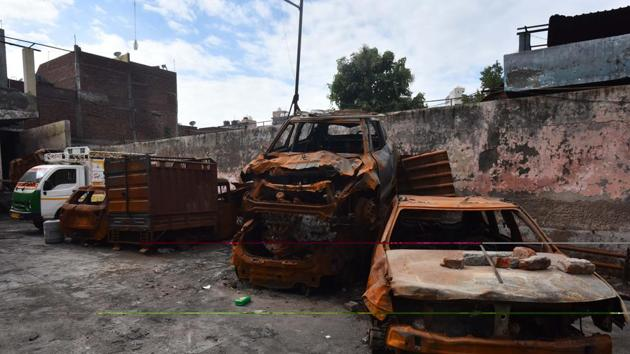 Damaged vehicles which were set fire during the Delhi riots seen dumped inside a parking lot six months after the North-East Delhi riots, at Shiv Vihar, in New Delhi.(Sanchit Khanna/HT PHOTO)
