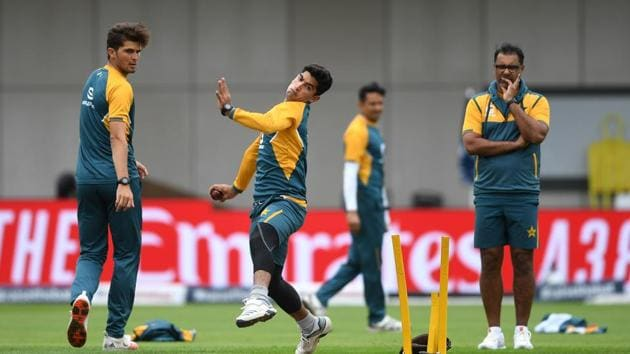 Nasim Shah of Pakistan bowls watched on by Shaheen Afridi and Pakistan's bowling coach Waqar Younis during a nets session at Old Trafford, Manchester.(PA Images via Getty Images)