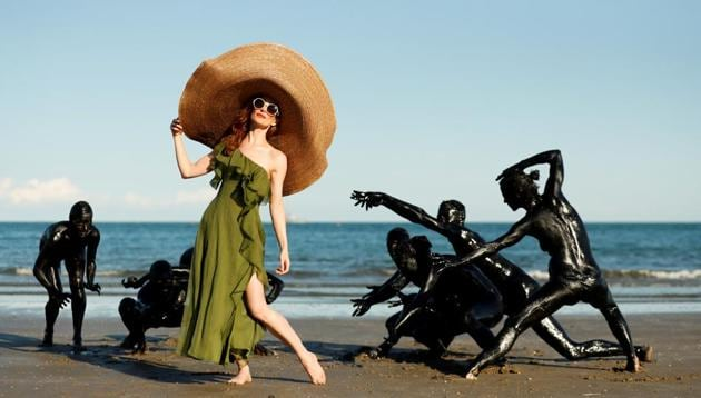 """The 77th Venice Film Festival - Venice, Italy September 3, 2020 - Actor Lotte Verbeek poses with performers at the beach for the shooting of the movie """"The Book of Vision"""" in the Critics' Week.(REUTERS)"""