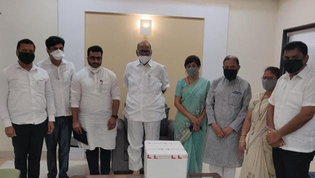 NCP supremo Sharad Pawad (centre) takes stock of the Covid-19 situation in Pune. Also seen are NCP leaders Amol Kolhe (third from left) and Vandana Chavan (fourth from right).