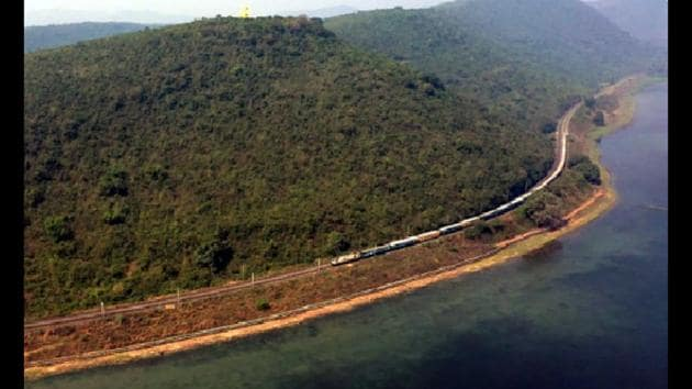 A bird's eye view of a train along the Chilika Lake.(Twitter@RailMinIndia)