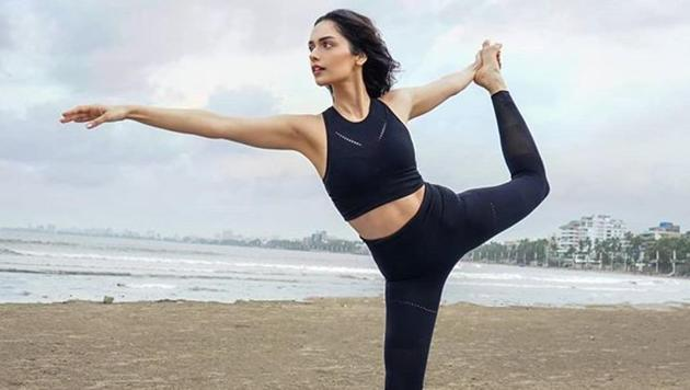 Taking to the photo-sharing platform Instagram, the 23-year-old model and actor, shared three pictures where she is seen stretching her body and doing yoga asanas alongside the sea.(Manushi Chhillar/Instagram)