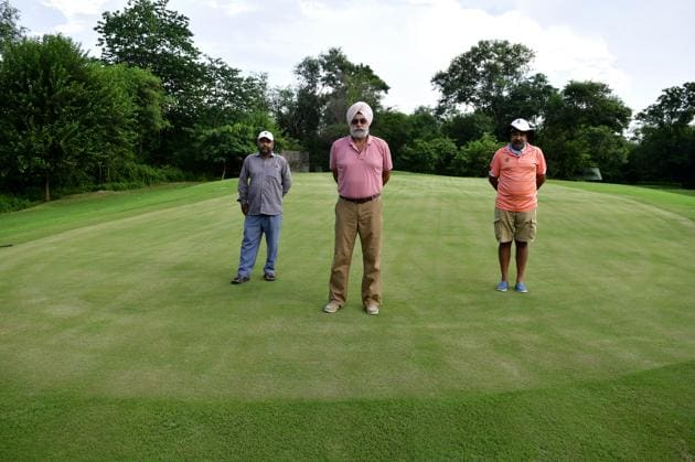 Ready for a round: SPS Matharoo, CGC captain (centre), Amrit Inder Singh, course manager and professional golfer (right) and Surjit Singh, assistant course manager, at the newly re-laid greens at hole 12 of the 18-hold Chandigarh Golf Course.(Ravi Kumar/HT PHOTO)