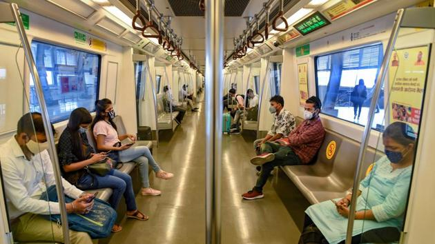 Commuters in a train after the Delhi Metro resumed services Monday.(PTI)