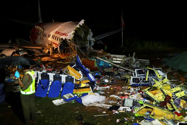 A security personnel stands guard in front of the August 7 wreckage of Air India Express jet, at Calicut International Airport in Kerala.(AFP)