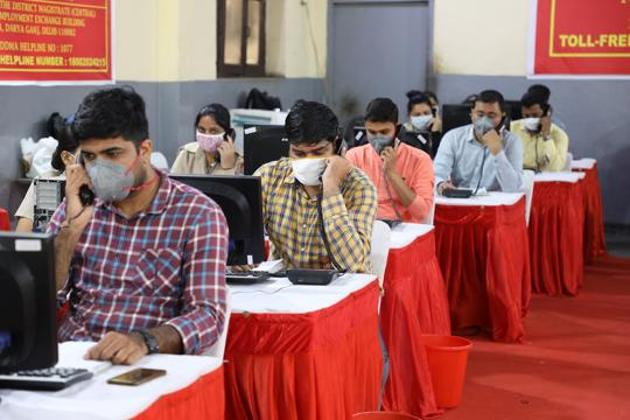 Civil defence members and counsellors work at the Covid-19 district surveillance and telemedicine hub at a school in New Delhi on August 2, 2020.(Bloomberg)