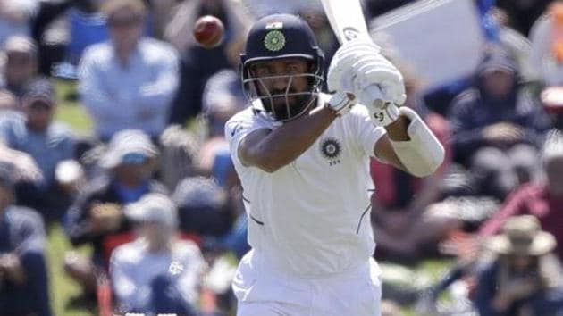 India's Cheteshwar Pujara watches the ball while battling during play on day one of the second cricket test between New Zealand and India at Hagley Oval in Christchurch.(AP)