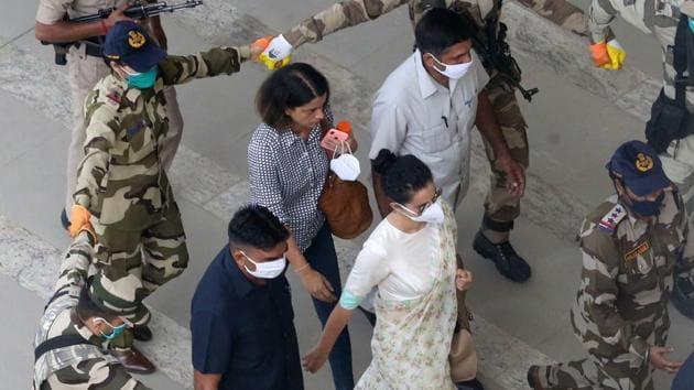 Security personnel accompany Kangana Ranaut at Chandigarh International Airport. (Photo by Gurminder Singh/Hindustan Times)