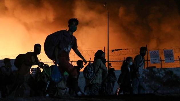Some 12,500 people were living at the Moria camp and the surrounding area, where additional restrictions have been imposed over the past week after a Somali resident tested positive for the coronavirus.(Reuters Photo)