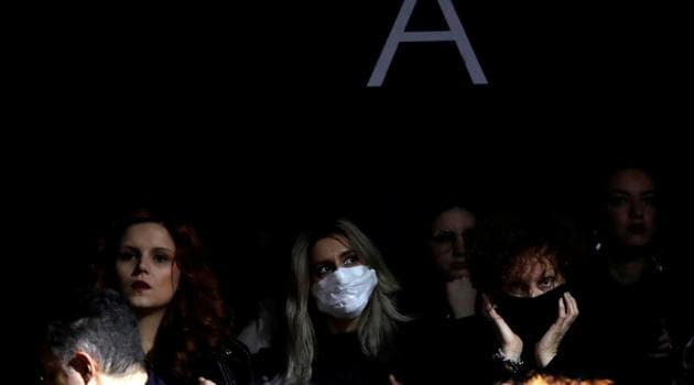 FILE PHOTO: A person in the audience wears a mask as she attends the Dolce & Gabbana Autumn/Winter 2020 collection show during Milan Fashion Week in Milan, Italy, February 23, 2020.(REUTERS)