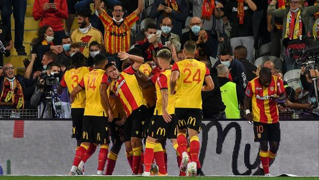 Lens' players celebrate after scoring their team's first goal during the French L1 football match between Racing Club de Lens (RCS) and Paris-Saint-Germain (PSG) at the Felix Bollaert-Delelis stadium in Lens.(AFP)