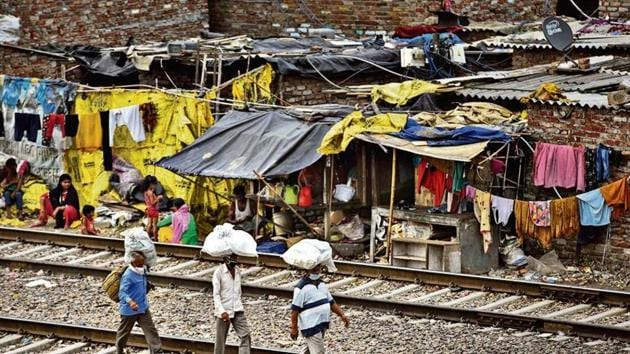 Targeting the AAP, the BJP said despite being in power for over five years, the ruling party has done little to rehabilitate slum dwellers.(Sanchit Khanna/ Hindustan Times)