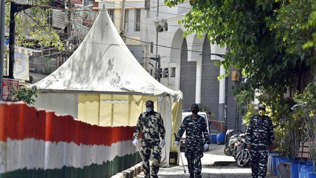 Paramilitary personnel seen at the cordoned off entry route to the Tablighi Jamaat's Alami Markaz Banglewali Masjid building on day twenty of the 21-day nationwide lockdown to curb the spread of coronavirus, in Nizamuddin, New Delhi.(Sanjeev Verma/HT FILE PHOTO)