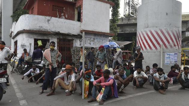 Labours sitting near the corner of road at Nishatganj, Lucknow, Uttar Pradesh,(HT Photo/Dheeraj Dhawan)